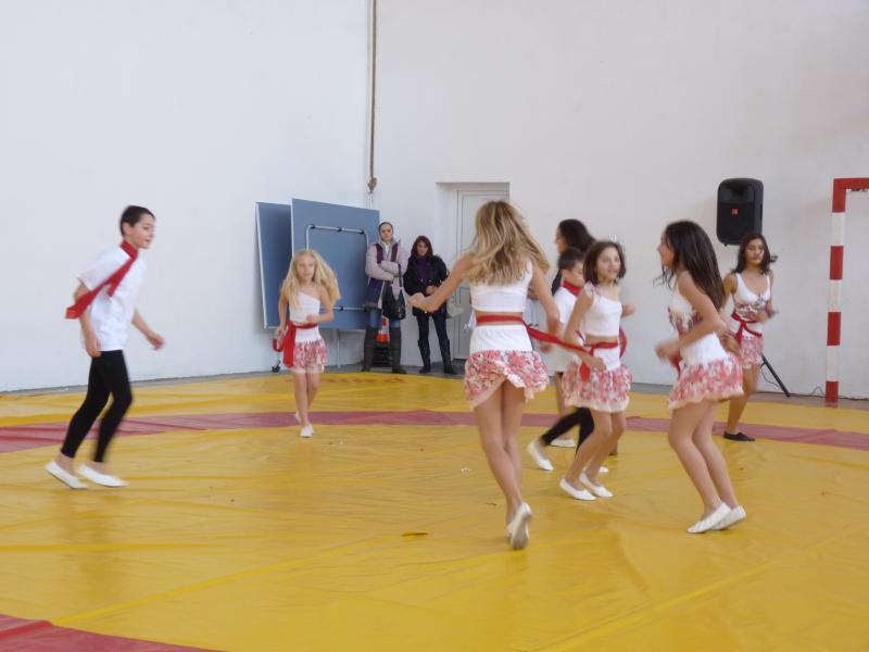 Students of the local school, performing for our boys