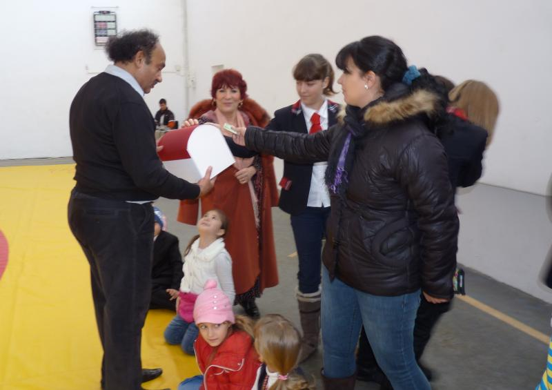 Prof. Martinescu collecting money for Amara house.